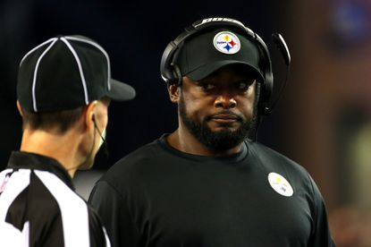 Head coach Mike Tomlin of the Pittsburgh Steelers speaks to an official in the first half against the New England Patriots at Gillette Stadium on September 10, 2015 in Foxboro, Massachusetts.The Steelers' coaches' headsets didn't work during the first half of the game.