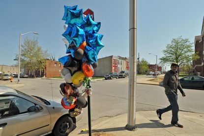 A memorial for Freddie Gray, at the corner of North Mount Street and Presbury Street, just east of the Gilmor Homes courtyard where Gray was arrested. Gray died on April 19 from spinal cord injuries, a week after he was taken into custody in Sandtown-Winchester by Baltimore City police.
