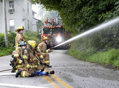 Firefighters mount an external attack on a fire in the 3200 Block of Sams Creek Road in Marston Wednesday, July 21, 2021. According to New Windsor fire company Chief Byron Welker, arriving units found a house well involved in fire and assumed a defensive operation to contain the fire. Responders from Carroll and Frederick Counties responded to the fire which was right at the county line.