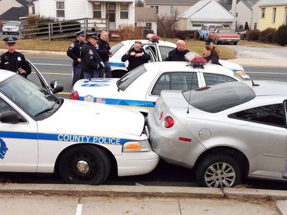 Baltimore Co. Police investigate the crime scene after a chase that began in Baltimore City.