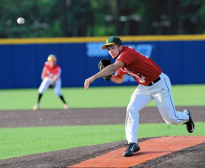 North Harford's Scott Angstadt delivers the pitch to the waiting South team batter during his turn on the mound in Tuesday's UCBAC All Star game at Harford Community College.