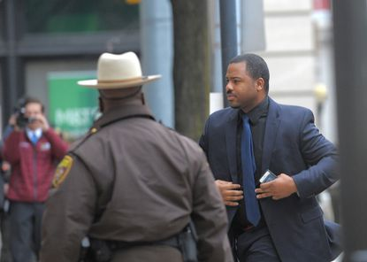 Baltimore PoliceOfficer William G. Porter enters a downtown courthouse during his trial last month. His attorneys are trying to prevent him from being forced to testify in the trials of other officers charged in the Freddie Gray case.