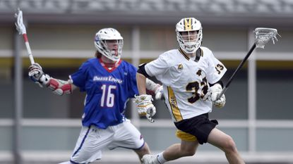 Senior long-stick midfielder Billy O'Hara (right, #33) and his defensive teammates on the UMBC men's lacrosse team shut out Hartford for 35:07 and gave up only one goal in the final 40:59 to power the Retrievers to an 8-3 win Saturday.