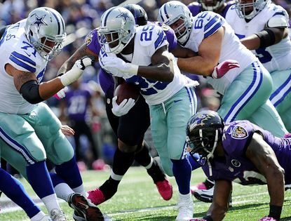 Dallas Cowboys running back DeMarco Murray runs for yardage against the Baltimore Ravens on Sunday in Baltimore.