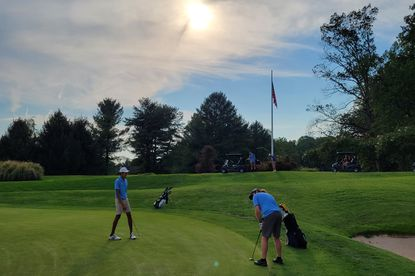 Members of the Howard High golf team putt on the ninth hole at Hobbits Glen during a match against Atholton on Sept. 15, 2021. (Submitted photo)