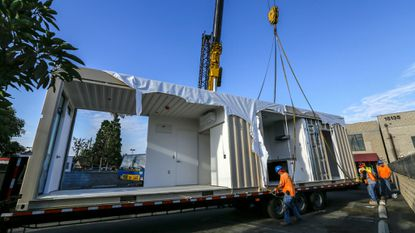 A Baltimore couple hopes that used shipping containers, like this one in California, can provide shelter that is quick and economical but also permanent and homelike.