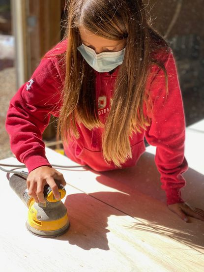 Brennan DeSantis, a seventh-grader at Southampton Middle School works on sanding desks. VolunTeen Leo Club built 120 folding desks for the virtual school year to donate to children in Harford County.