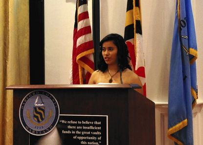 Alejandra Huezo, an 18-year-old senior at Bel Air High School, reads her first-place essay during the 2014 Harford County Humanitarian Awards Luncheon Tuesday.