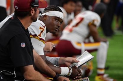 Rookie Dwayne Haskins, shown here watching last Thursday's game from the sideline, will start Sunday in Buffalo because Case Keenum won't be able to play.