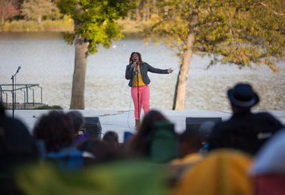 Kiessence Polk, winner of the 2012 Columbia Teen Idol Competition, sings in front of the crowd.