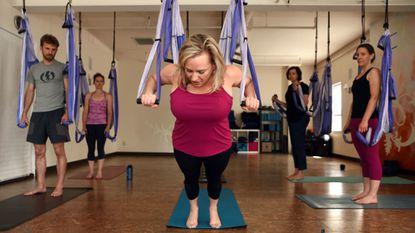 Jo Anne Rickard-Barnosky (center) teaches Yoga Trapeze at Yoga Love in Highland.