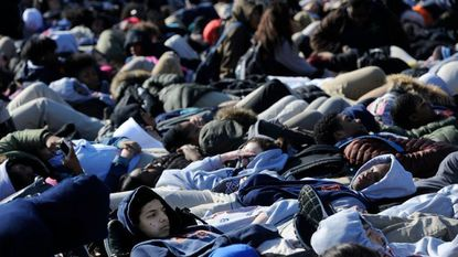 """Baltimore Polytechnic Institute students staged a """"lie-in"""" for 17 minutes to memorialize the 17 lives lost in the Parkland shooting."""