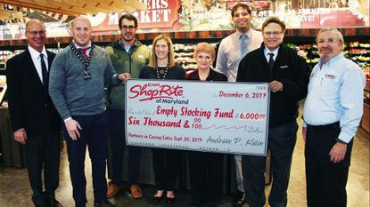 From left, Howard Klein, Jacob Klein, Stephen Klein, Sarah Klein, Empty Stocking Fund board member Jane Brown, Marshall Klein, Andrew Klein and Empty Stocking Fund board member Garry Wolfe. Klein's ShopRite and the Klein family donated $6,000 to the Harford County charity.