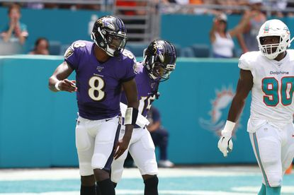 Baltimore Ravens quarterback Lamar Jackson (8) and Baltimore Ravens wide receiver Marquise Brown (15) talk after Brown scores a touchdown, during the first half at an NFL football game, Sunday, Sept. 8, 2019, in Miami Gardens, Fla.