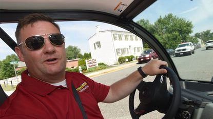 """Havre de Grace Mayor William T. Martin, shown behind the wheel of one of the electric vehicles the city acquired under his leadership, sent out a press release touting his selection as """"Best Elected Official"""" in Harford Magazine's annual Best of Harford readers' poll."""