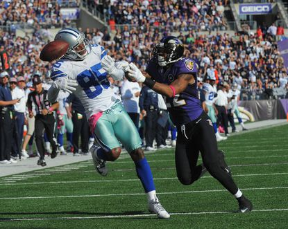Ravens cornerback Jimmy Smith breaks up a pass intended for Cowboys receiver Kevin Ogletree in the fourth quarter Sunday.