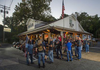 Regulars gather outside of Daniels Restaurant and Bar in Elkridge.