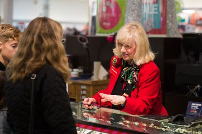 Barbara Cake shows watches to customers at the J.C. Penney jewelry counter in Hermitage, Pennsylvania on December 23, 2017.