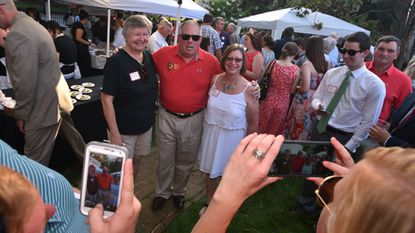 People take photos with Gov. Larry Hogan while at the Buy Local Cookout in 2016.