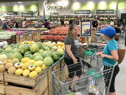 Erinn Ragan, left, of Bel Air, chats with Amy Bauer, of Joppa, as they shop at the new Sprouts Farmers Market store in Bel Air. The store opened to the public Wednesday morning.