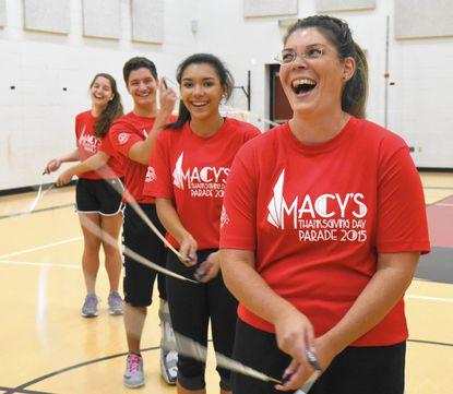 From the front, Megan Reith, Kayla Turner, Spencer and Sydney Billings, practice some jump roping at Prospect Mill Elementary School in preparation for their appearance in the Macy's Thanksgiving Day Parade in New York City.