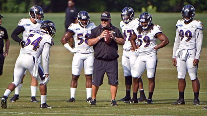 Ravens linebackers coach Don Martindale, center, conducts practice with his players during training camp at Under Armour Performance Center.