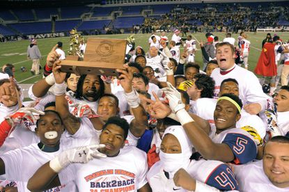 Franklin celebrates its 35-21 win over Damascus in the Class 3A state championship in December.