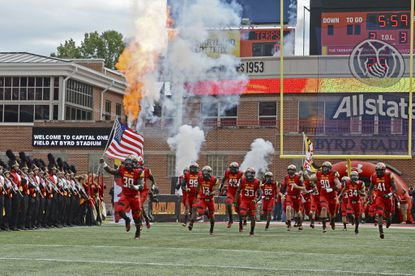 The Maryland Terrapins players take the field for their first BIG 10 conference game against the Ohio State Buckeyes at Byrd Stadium.