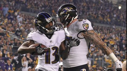 Baltimore Ravens wide receiver John Brown (13) celebrates with Maxx Williams after a 33-yard touchdown reception in the first half in Sunday's game against the Pittsburgh Steelers.
