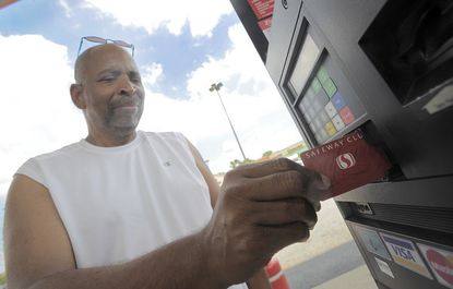 J.D. Taylor of Woodlawn inserts his Safeway Club card to take advantage of a three-cent discount at the Catonsville Safeway on Baltimore National Pike