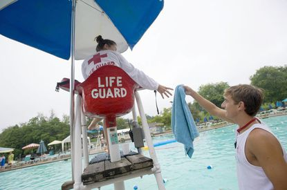 Just one year ago, scenes such as lifeguard Conor Sheehey getting a towel for Alyssa Bitzeo at Padonia Park Swim Club, would be common across Maryland during Memorial Day weekend. Now, pools are sitting idle as the state and operators mull the next steps as coronavirus looms.