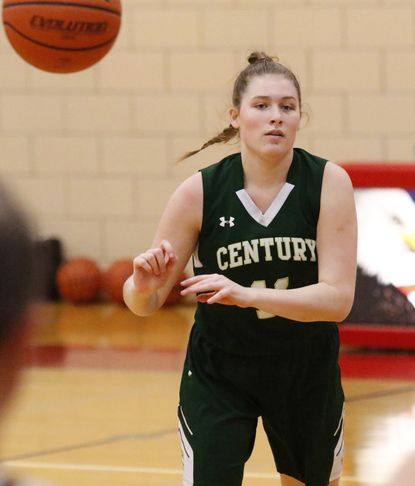 Century's Jess Diorio passes against Francis Scott Key in girls basketball at FSK.