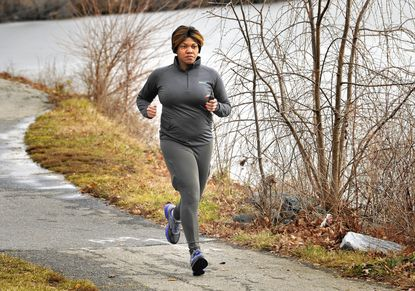 Alfena Rascoe jogs near a lake in Laurel. She uses DietBet to stay motivated.