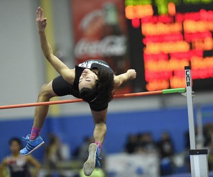 Westminster's Tevin Bailey clears 6-feet-2 on the high jump during the MPSSAA state indoor track and field championships.