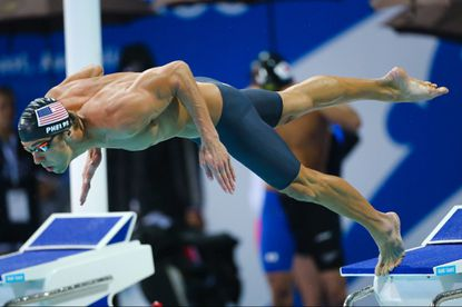 Michael Phelps dives in during the 4x100-meter freestyle relay final at the Pan Pacific Championships.