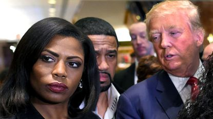 "In this photo from 2015, Omarosa Manigault Newman appears alongside Donald Trump during a press conference. Trump called his former White House aide a ""dog"" on Twitter this week in the wake of allegations she made about him in a new book."
