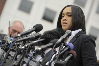 Baltimore State's Attorney Marilyn J. Mosby responds to a question at a press conference outside the War Memorial Building talking about the charges against six police officers involved in the arrest of Freddie Gray.