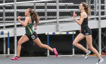 Century's Isabella Mastria, left, and South Carroll's Madelyn Boyce, seen in this file photo from the 2021 Carroll County outdoor track championship meet, each earned top three finishes in the 400 at the 2A state championships on Saturday.