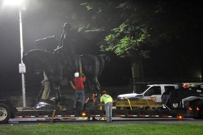 The Jackson-Lee Monument in Wyman Park is removed on August 17, 2017 in the middle of the night.