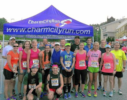 Runners in the Charles Street 12 race from Lutherville, Cockeysville and Timonium gathered for a pre-run photo. Pictured are front row: Jim Archibald, Anastasia Hagerich; middle row Melanie Voelker, Kieran Brune, Lauren Edwards, Josh Levinson, Melody Sinclair, Marianne Pizzo, Maeve Sheehey, Cesar Arze, Scott Masengill and in the back row are Jonathan Sagner and Phil Sheehey with runners who were not identified.