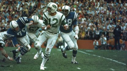 New York Jets quarterback (12) Joe Namath gets off a pass under pressure from the Baltimore Colts defenders during Super Bowl III in Miami, Fla., on Sunday, Jan. 12, 1969.