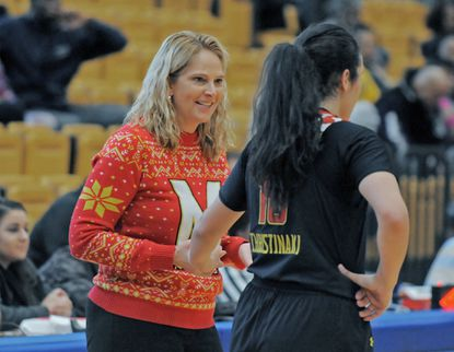Maryland' head coach Brenda Frese, left, talks with Eleanna Christinaki during a game against Coppin State.