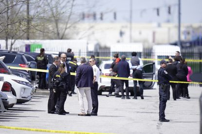 """Public safety officials investigate on Friday, April 16, 2021, the scene of a mass shooting at the FedEx facility in Indianapolis on Thursday evening. Prosecutors never sought to invoke a """"red flag"""" law that would have kept Brandon Hole, who shot and killed eight people before killing himself, from obtaining guns, even after he had been deemed too dangerous to possess a shotgun, a top law enforcement official said on Monday, April 19, 2021. (Stacy Able/New York Times)"""