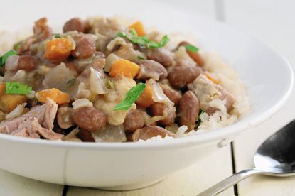 Beans are cooked with plenty of aromatic vegetables for a spin on red beans and rice.