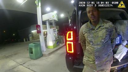In this image made from Windsor, Virginia police video, an officer speaks with Caron Nazario during a traffic stop on Dec. 20, 2020, in Windsor. The second lieutenant in the U.S. Army is now suing two Virginia police officers over a traffic stop during which he says the officers drew their guns and pointed them at him as he was dressed in uniform. (Windsor Police via AP).