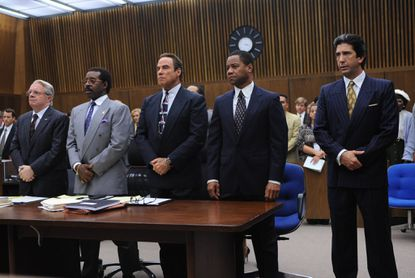 From left, Nathan Lane as F. Lee Bailey, Courtney B. Vance as Johnnie Cochran, John Travolta as Robert Shapiro, Cuba Gooding Jr. as O.J. Simpson, David Schwimmer as Robert Kardashian.