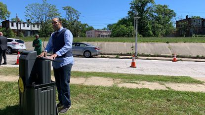 Mark Washington, the director of the Coldstream Homestead Montebello Community Corp., talks Friday about a plan to build homes on a span of empty lots.