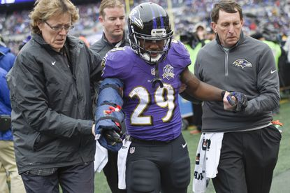 Baltimore Ravens running back Justin Forsett (29) is helped off the field after an injury during the first half of an NFL football game against the St. Louis Rams in Baltimore, Sunday, Nov. 22, 2015.