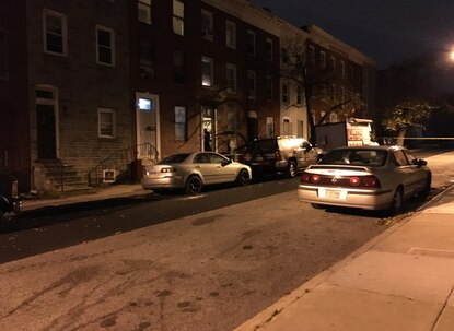 Baltimore police investigate a triple homicide in the 900 block of Bennett Place.