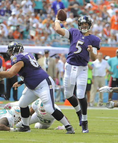 Ravens quarterback Joe Flacco throws a pass against the Miami Dolphins in the first quarter.